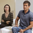 Young couple sitting in hotel room - Foto de Stock