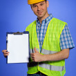 Portrait of architect holding clipboard and showing thumbs up sign — Stock Photo #3822014
