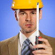 Portrait of businessman in hardhat holding tape measure — Stock Photo