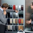 Salesperson showing color swatch to customer — Stock Photo