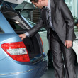 Car salesperson checking new car - Stock Photo