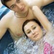 Couple bathing at jacuzzi — Stock Photo