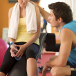 Stock Photo: Man and Woman Talking in Health Club