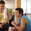 Man and Woman Talking in Health Club — Stock Photo #3823428