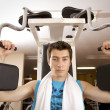 A young man exercising at gym - Lizenzfreies Foto