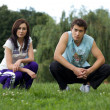 Young couple exercising in park — Stock Photo #3824412