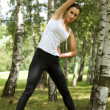 Young woman exercising in park - Lizenzfreies Foto