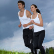 Young couple exercising in park - Lizenzfreies Foto