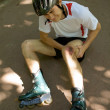 Skater injured and clutching leg - Foto de Stock