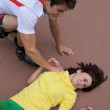 Skater injured and clutching arm - Foto de Stock