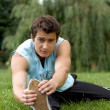 Young man exercising in park - Stock Photo