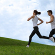 Royalty-Free Stock Photo: Young couple exercising in park