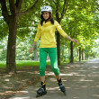 Yong woman riding roller skate - Stock Photo