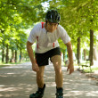 Young man riding roller skates — Stock Photo