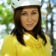 Portrait of woman in cycle helmet - Foto Stock