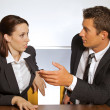 Businessman and woman in conversation at office — Stock Photo
