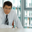 Portrait of young confident caucasian businessman -  