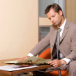 Businessman reading newspaper -  