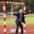 Businessman defending goal -  