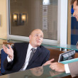 Businessmen conversing at office -  