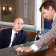 Businessmen conversing at office — Stock Photo