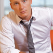 Portrait of businessman at office - Stock Photo
