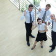 Businessmen and woman standing by railing with hands raised, portrait — Stock Photo