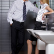 Young business couple talking intimately in office washroom — Stock Photo #3829156