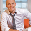 Portrait of businessman smiling at office — Stock Photo