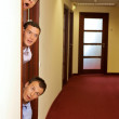 Stock Photo: Businessmen peeking out of door