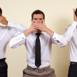 Three businessman covering eyes, mouth and ears — Stock Photo