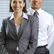 Portrait of smiling businessmand womin office — Stock Photo #3829401