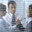 Business conversing in office - Stock Photo
