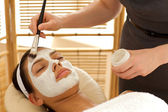 Close-up of young woman receiving beauty treatment in spa — Stock Photo