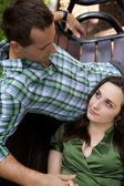 Girlfriend resting head on boyfriend's lap — Stock Photo