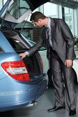 Car salesperson checking new car — Stock Photo