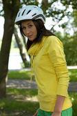 Portrait of woman in cycle helmet — Stock Photo
