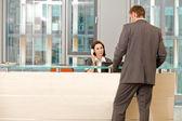 Young caucassian secretary assisting businessman — Stock Photo