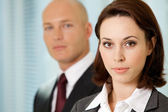 Portrait of young caucasian businessman and businesswoman in office — Stock Photo