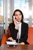 Businesswoman conversing on landline phone — Foto Stock