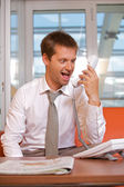 Businessman shouting on landline phone — Stock Photo