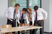 Business team looking at document in office — Stock Photo