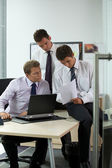 Businessmen looking at document in office — Stock Photo
