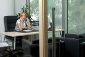 Businesswoman using phone at office — Foto Stock