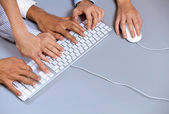 Hands typing on computer keyboard, elevated view — Stock Photo