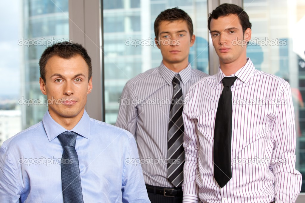 Three businessmen at office, portrait  Stock Photo #3829370