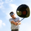 Young man playing golf, low angle view — Foto Stock