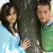 Portrait of young couple by tree — Stock Photo #3830255