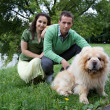 Stock Photo: Portrait of young couple with dog