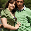 Stock Photo: Portrait of young couple with arm around